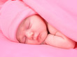 Newborn Baby Girl Sleeping with Blanket and Hat