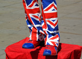 Street entertainer wearing a suit made of the Union Jack poster