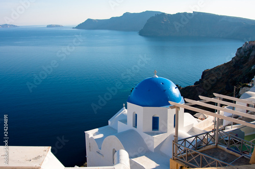 Church in OIa on Island of Santorini with bay view of Volcano