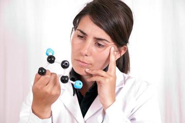 woman scientist with organic molecule