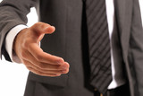 Unrecognizable businessman handshake closeup isolated on white poster