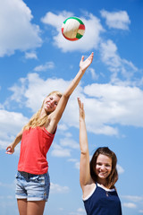 Young girls playing volleyball