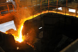 pouring molten steel in transportation device poster