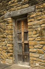 Stone wall with old wood  door