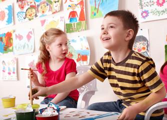 Children painting in art class.