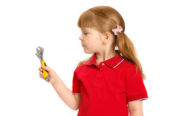 The little girl with a wrench on the white