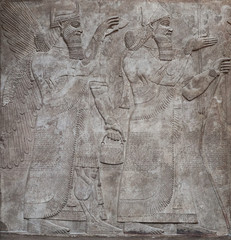 Ancient relief of assyrian gods