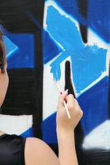 Making graffiti on wall
