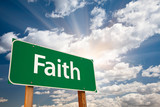 Faith Green Road Sign Over Clouds poster