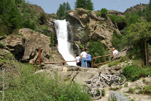 Excursion by bicycle close to a waterfall