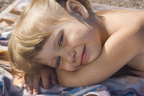 Girl resting on a towel