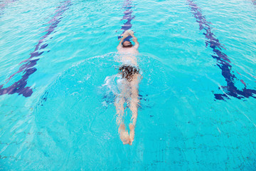 Young man diving in swimming pool