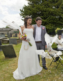 Bride and Groom releasing Doves poster