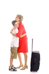 woman hugging boy leaving