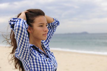 beautiful woman relaxing by the sea with copy space