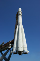 Space rocket on blue sky background