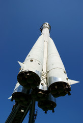 Space rocket on blue sky background