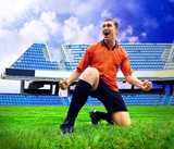 Happiness football player after goal on the field of stadium und poster