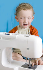 small red-haired boy and the sewing machine