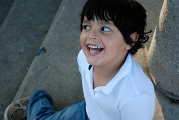 Beautiful Hispanic boy laughing