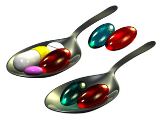 Pills on spoon, white background