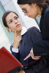 two businesswomen working with laptop