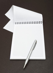 A white note book with lots of room for your text or image on a