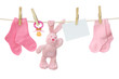 Pink baby goods and blank note hanging on the clothesline