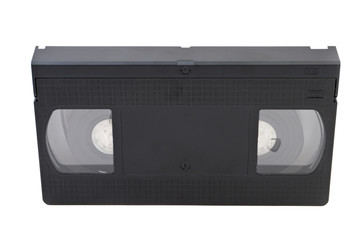 Old obsolete videocassette on white background