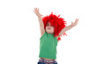 kid wearing a red feather wig