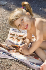 Girl on a towel laughing