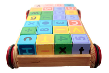 childrens play letter blocks in cart