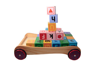 childrens play letter blocks in toy cart isolated on white