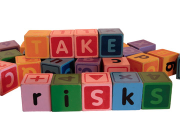 take risks in multi colored play blocks