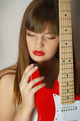 Portrait of the beautiful sexual girl with the red guitar l