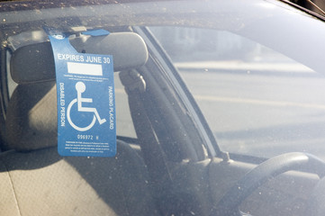 Handicap Sign on a Rear View Mirror