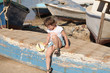 young girl sits on the boat