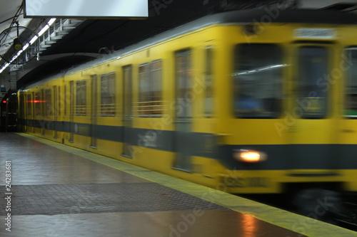 Leinwanddruck Bild Subway train leaving the station