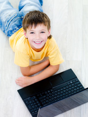 High angle portrait of boy with laptop