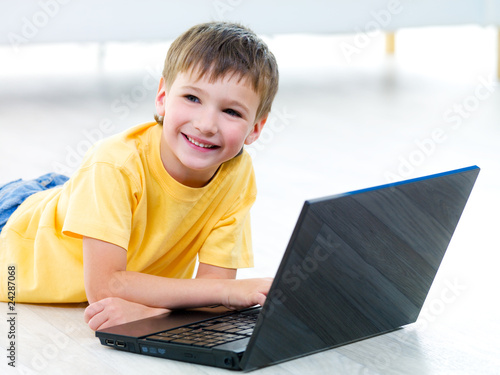 Happy boy with laptop