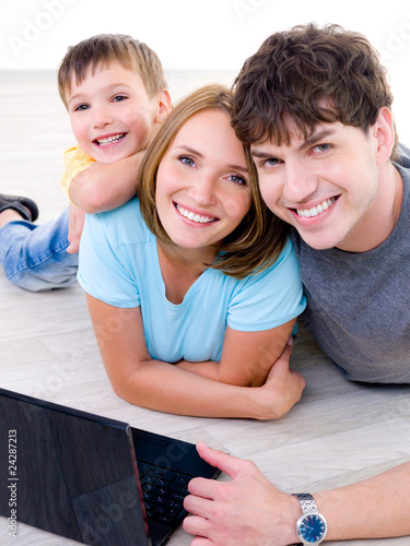 Happy laughing family with laptop