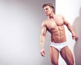 Handsome muscular guy in the studio