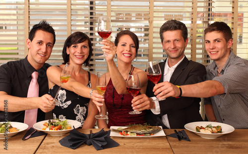 friends in a restaurant - cheers clink glasses -food