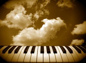 fondo musica teclas de piano y cielo sepia