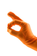 hand in orange glove is making the ok sign