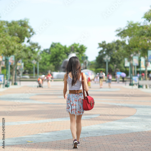 fashion girl walking on street with soft color tone