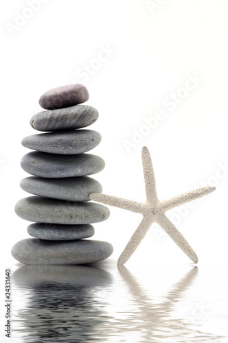 Stacked zen stones with starfish
