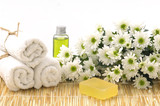 Body relax composition with towel, soap bars, oil, daisy