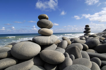 Tropical beach – balanced rocks ,sea and sky
