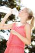 Junge Frau trinkt Wasser im Freien, Young woman drinking water 2